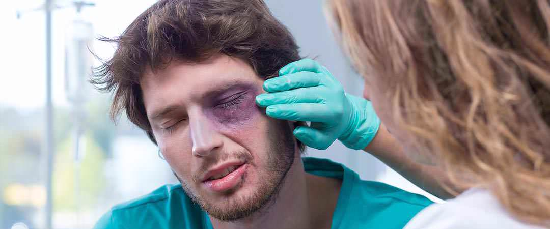 Man receiving treatment for an eye injury