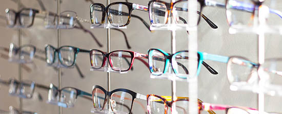 Inside view of an optical with rows of eyeglasses.